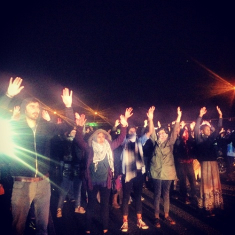 Hands Up. Don't Shoot. Oakland protests the grand jury decision. Photo by Cece Carpio