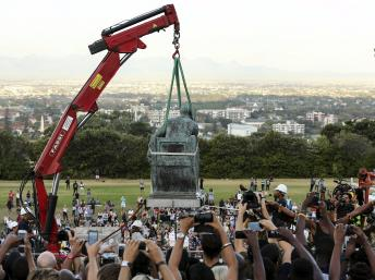 """Rhodes statue goes but protesters take on other symbols of South Africa's past"" http://www.english.rfi.fr/africa/20150410-rhodes-statue-goes-row-spreads-other-symbols-south-africas-past"